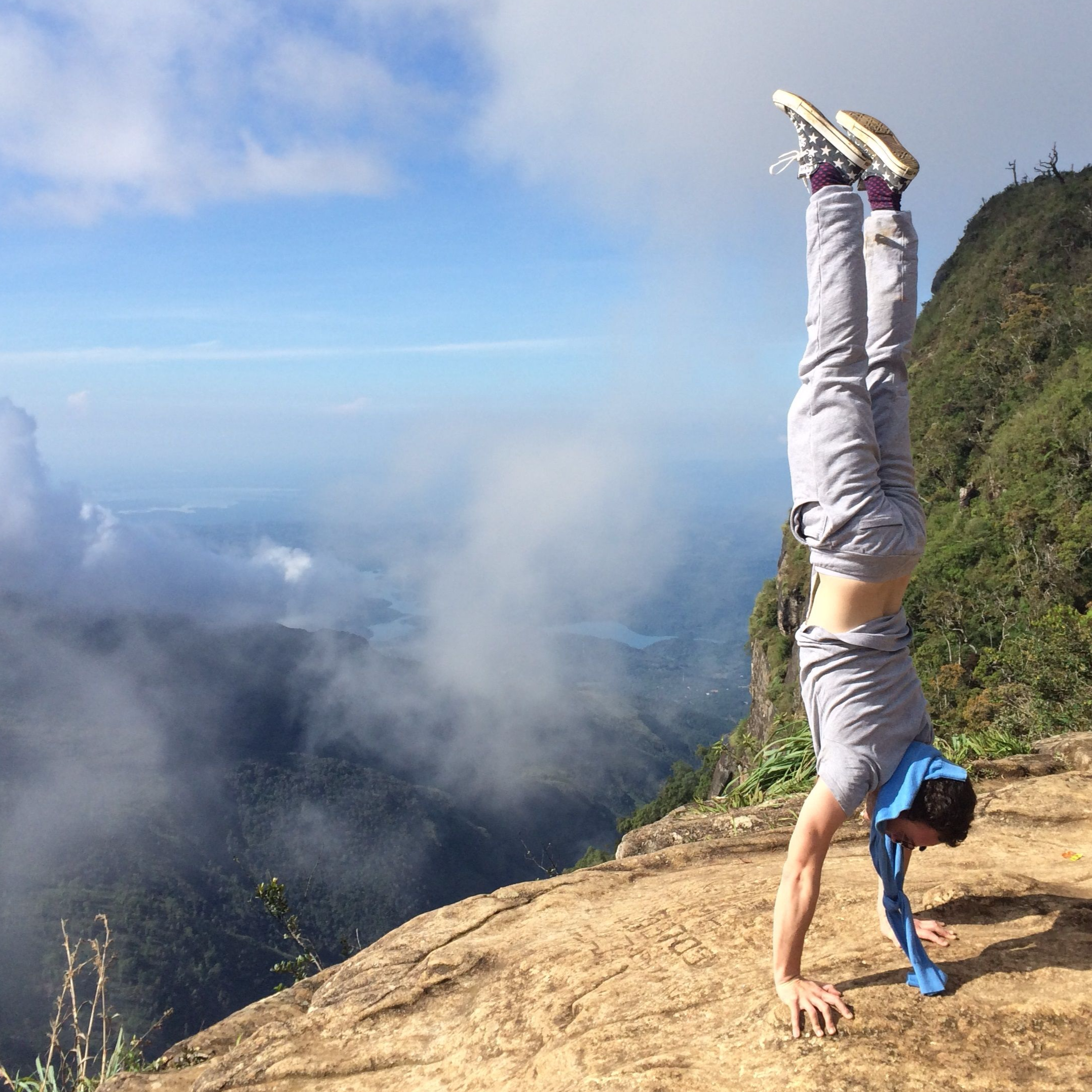 Luminousyogi doing a handstand at Worlds End